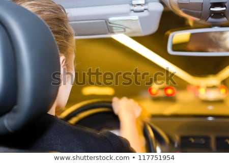 Young woman drives trough tunnel with car Stock photo © Kzenon