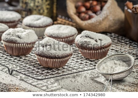 muffins with cinnamon and icing sugar stock photo © elmiko