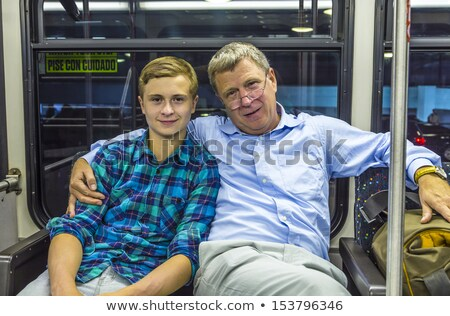 father and son at the airport bus after arrival  Stock photo © meinzahn