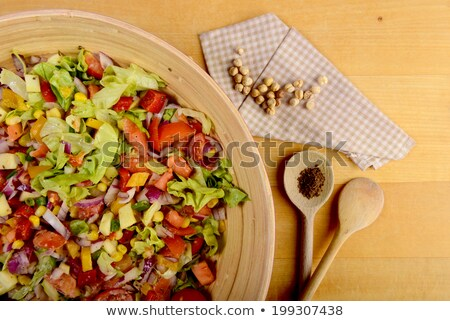 Big bowl of fresh vegetable salad with chickpeas and cumin Stock photo © jeliva