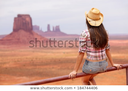 cowgirl woman enjoying view of monument valley stock photo © maridav