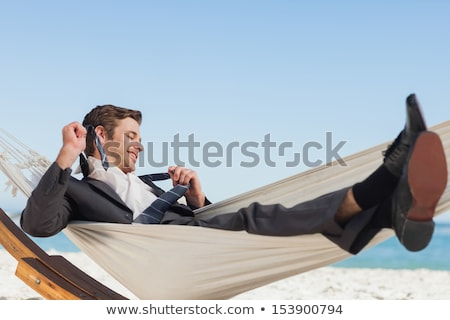 Young businessman loosening a tie  Stock photo © jeliva