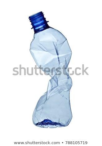 empty used plastic bottles on white background stock photo © frameangel