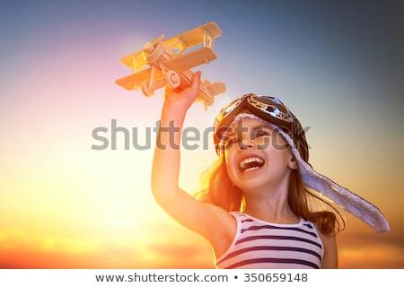 Foto d'archivio: Happy Kid In Helmet Pilot Playing
