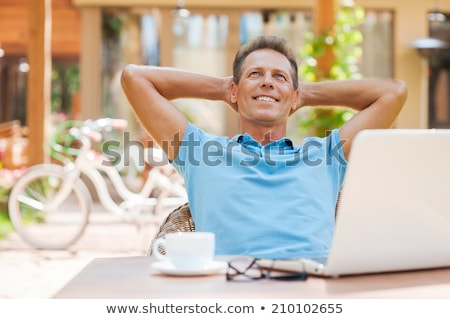 businessman relaxing cafe stock photo © hasloo