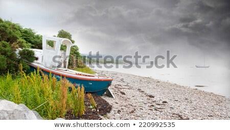 houten · boot · stormachtig · zee · hemel · water - stockfoto © michaklootwijk