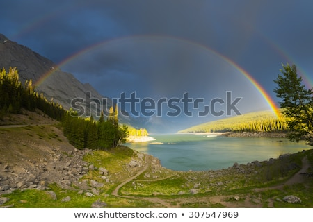 Stock photo: Double Rainbow over Landscape at Sunset