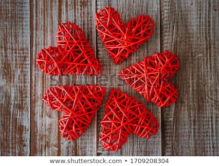 Wicker wood weave in heart shape pattern background Stock photo © FrameAngel