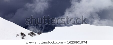 Stock photo: Off-piste slope and storm gray clouds