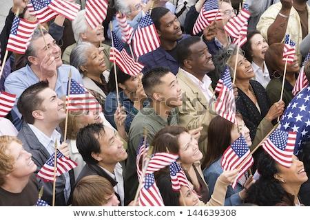 Happy patriotic young Vietnamese woman Stock photo © smithore