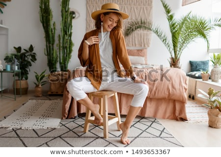 Happy beautiful woman sitting on the wooden chair Stock photo © deandrobot