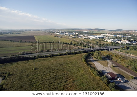 Highly detailed aerial city view with crossroads, roads, houses, Stock photo © slunicko