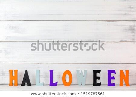 Hátborzongató szörny betűtípus karakter fehér felirat Stock fotó © Melvin07