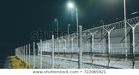 Security fence in prison stock photo © traza
