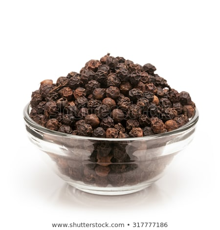 Front view of bowl of Organic Black pepper. Stock photo © ziprashantzi