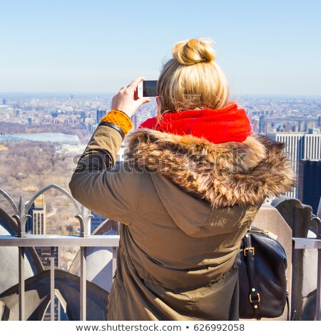 Blond tourist girl taking photos in Central Park NYC Stock photo © lunamarina