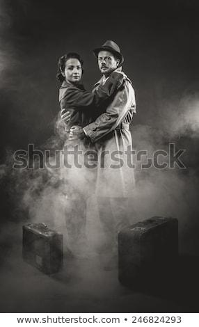 Film noir: elegant couple leaving in the dark Stock photo © stokkete