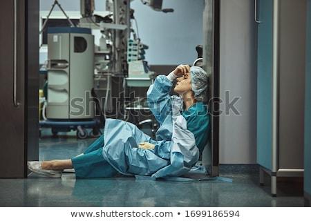 Cansado mulher cirurgião operação médico Foto stock © Flareimage