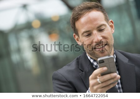 businessman looking down stock photo © cherezoff