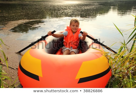 boy and inflatable boat on lawn Stock photo © Paha_L