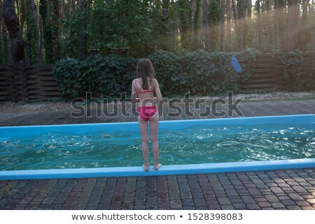 Happy family with little girl bathe in pool Stock photo © Paha_L