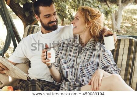 beautiful young woman sitting on the seesaw stock photo © konradbak
