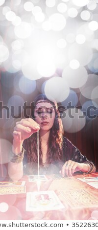 Composite image of fortune teller using tarot cards Stock photo © wavebreak_media