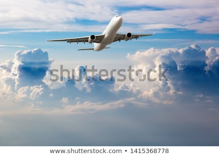 aircraft wing in a cloudy stormy clouds sky stock photo © lunamarina