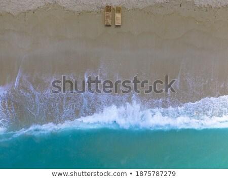 beautiful soft waves break on the beach stock photo © morrbyte