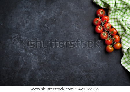 Maturo pomodorini pietra tavolo da cucina top view Foto d'archivio © karandaev