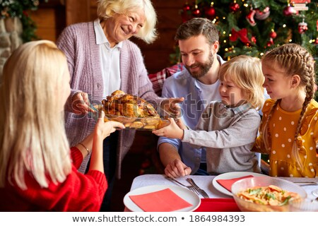 grandma with a christmas or thanksgiving roast turkey stock photo © studiostoks