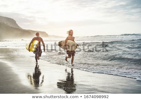 Surfer man going longboard surfing on maui beach Stock photo © Maridav