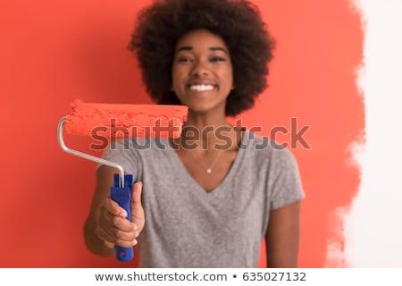 fiatal · nő · választ · új · festék · ház · tervek - stock fotó © dash