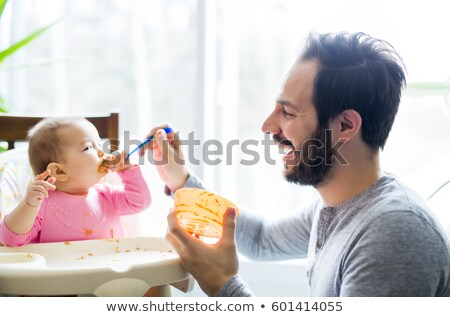 young father is feeding his baby stock photo © o_lypa