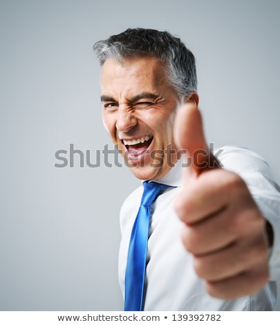 Vertical image of man showing thumb up Stock photo © deandrobot