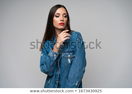 Beautiful seductive young woman with red lips standing and posing Stock photo © deandrobot