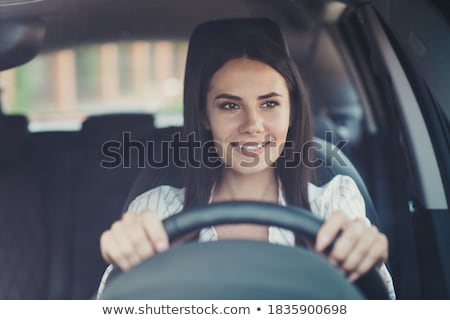 Cheerful young businesswoman going out of her car Stock photo © deandrobot