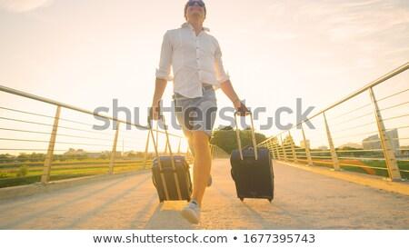 jeune · homme · étroite · valise · homme · séance · frustré - photo stock © rastudio