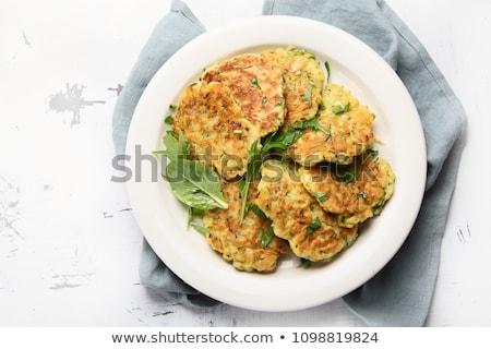 Courgette plantaardige pannenkoeken voedsel achtergrond tabel Stockfoto © yelenayemchuk