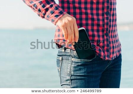 スマートフォン ポケット デニム ズボン ジーンズ 技術 ストックフォト © dolgachov