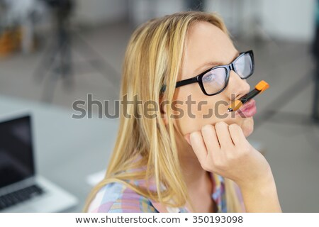 close up image of carefree blonde business woman in eyeglasses stock photo © deandrobot