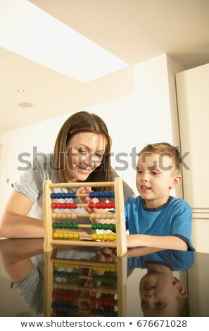 mum and son with abacus Stock photo © IS2