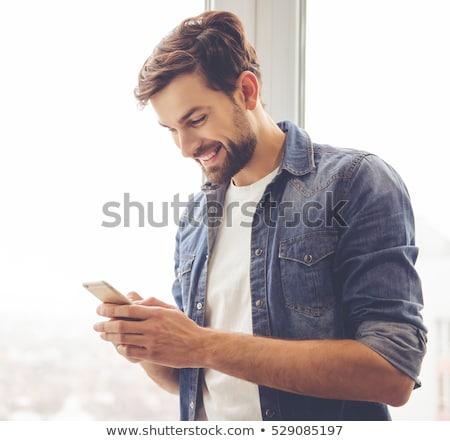 Glimlachend bebaarde man business kleding praten Stockfoto © deandrobot