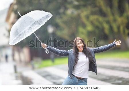 Menina cantando guarda-chuva chuva diversão Foto stock © IS2