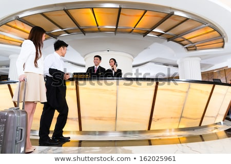 Asiático hotel recepção secretária corporativo pessoas de negócios Foto stock © studioworkstock