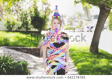 Young blonde woman with party streamer Stock photo © IS2