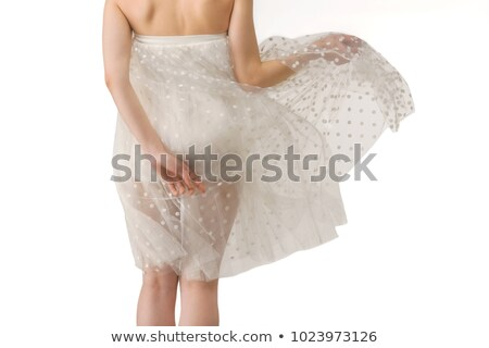 midsection view of woman posing in elegant white dress, isolated on pink stock photo © LightFieldStudios