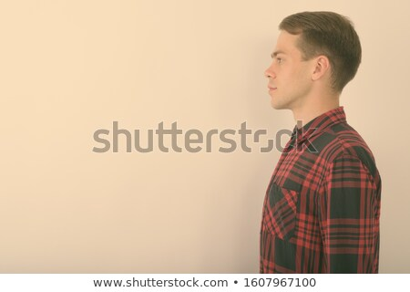 side view of handsome casual man wearing red checkers shirt Stock photo © feedough