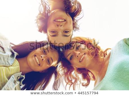 three smiling happy girls having fun on vacation stock photo © neonshot