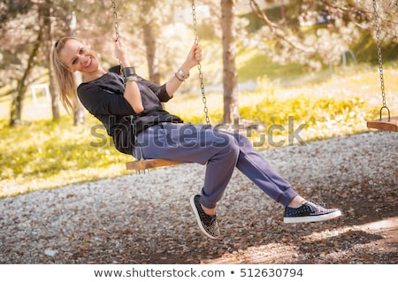 Young Woman Sitting In Playground Stock photo © monkey_business